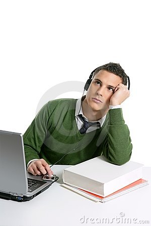 Young man student with computer and music headphones