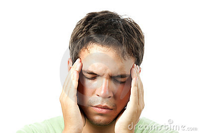 Young man suffering from a headache isolated