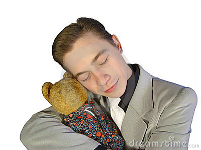 The young man in a suit, embracing a toy bear