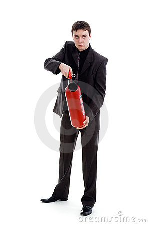 Young man in a suit holding a fire extinguisher.