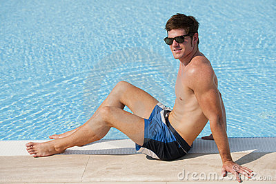Young man by swimming-pool