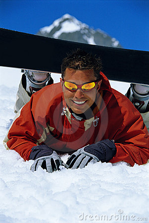 Free Young Man Taking A Break From Snowboarding Stock Photo - 6077320