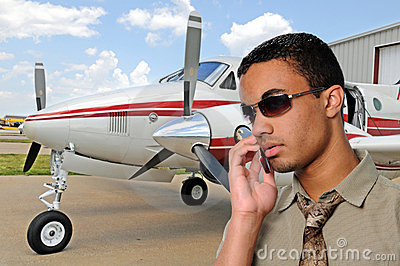 Young Man Talking on a Cell Phone at Airport