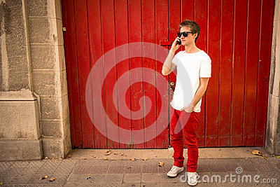 Young man talking on the phone in the city