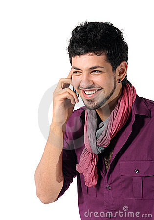Young man talking on the phone on the white