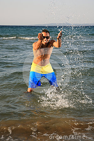 Young man throwing water