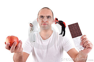 Young man torn between eating an apple and a choco