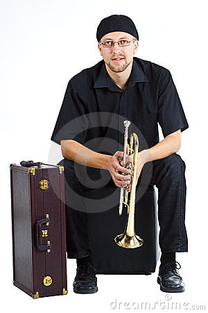 Young man with trumpet and suitcase
