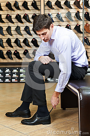 Free Young Man Trying On Shoes Stock Images - 28722334