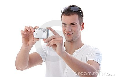 Young man using digital camera smiling