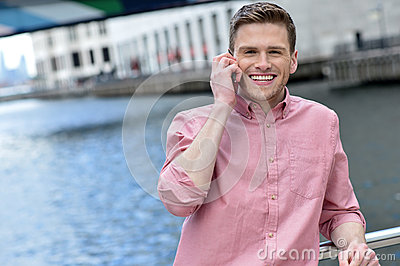Young man using his mobile phone at outdoors