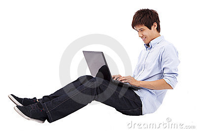 Young man using laptop on the floor