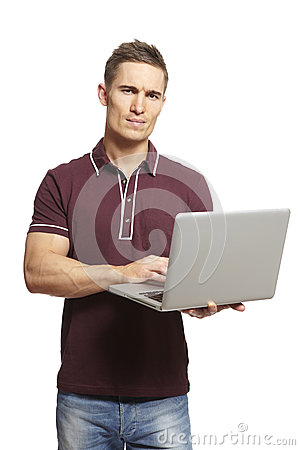 Young man using laptop looking confused