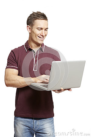 Young man using laptop smiling