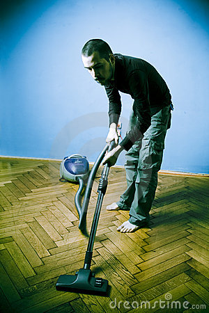 Young Man Vacuuming