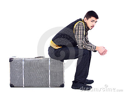 Young man waiting at airport, isolated