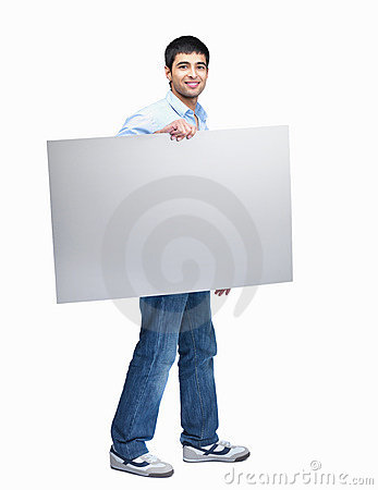 Young man walking with an empty white billboard