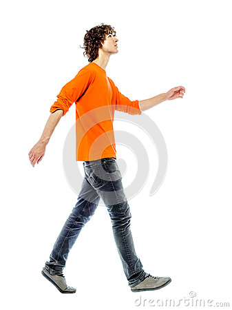 Young man walking  looking up side view