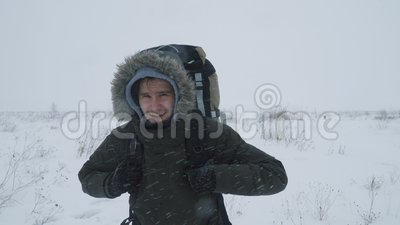 Young Man Walking Through A Snowstorm Stock Video Video