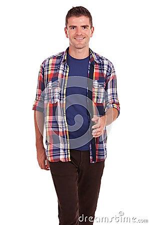 Young man walking towards the camera