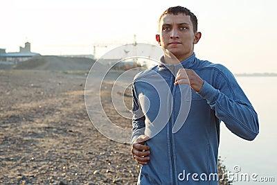 Young man warming-up at early morning