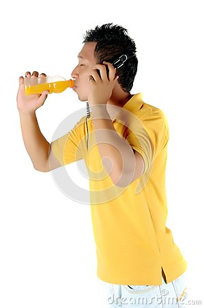 a young man was drinking a bottle of orange juice