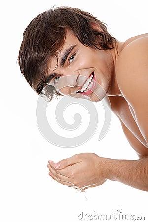 Free Young Man Washing His Face Stock Image - 18753481