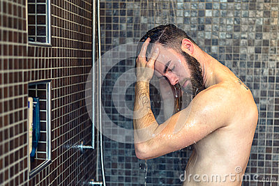 Young Man Washing His Hair In The Shower Stock Photo