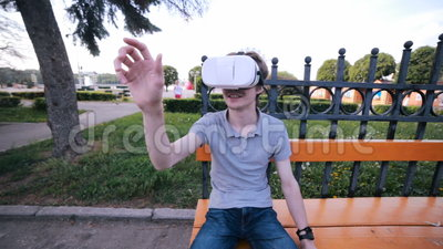 Young man watching 360 degree video virtual reality using VR glasses. HD