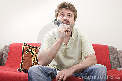Young man is watching TV