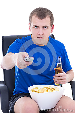 Young man watching tv with chips and bottle of beer isolated on