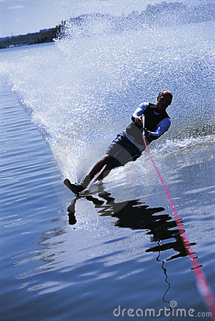 A young man water skiing