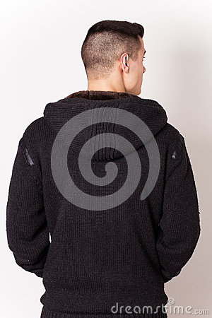 Young man wearing black dress back
