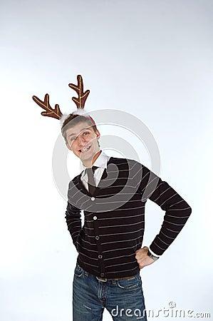 Young man wearing deer s horns