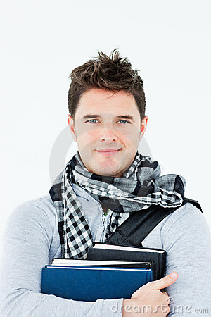 Young man wearing a scarf and holding books