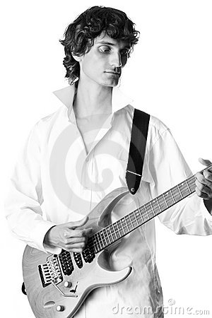 Young man in white shirt playing electric guitar