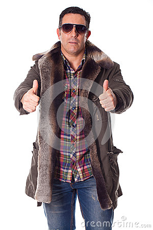 Young man in a winter clothing with positive attitudeSt