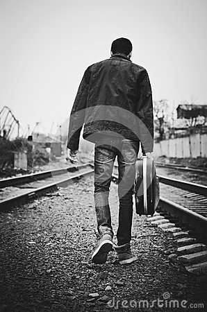 Free Young Man With Guitar Case In Hand Is Going Away. Rear View, Black And White Royalty Free Stock Photos - 34115008