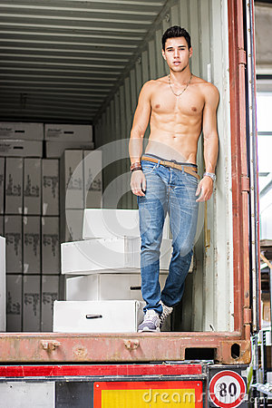 Free Young Man With Large White Box By Freight Train Royalty Free Stock Photography - 63066577