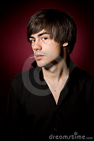 Free Young Man With Toothpick In Black Shirt Royalty Free Stock Photos - 12167618