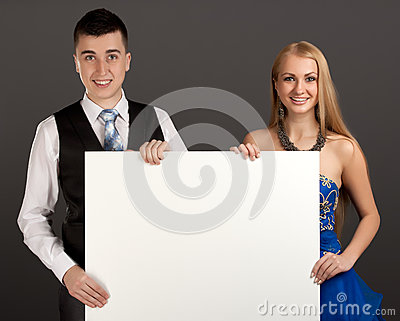 Young man and woman with blank board