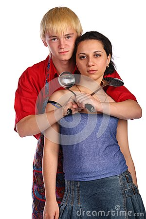 Young man and woman embraces with utensil