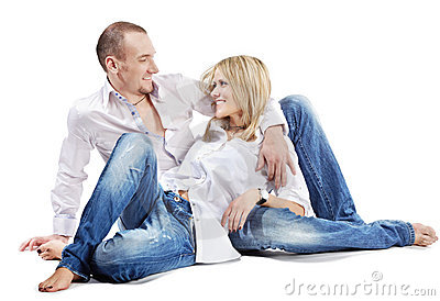 Young man and woman sit on floor Stock Photo