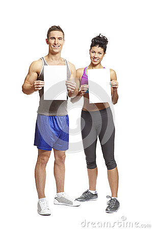 Young man and woman in sports outfits holding blank cards