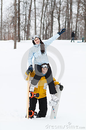 Young man and woman with treir snowboards