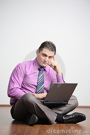 Young man working on a laptop computer