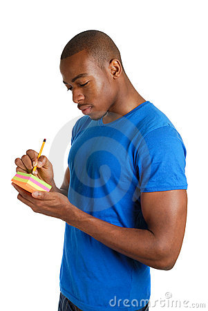Free Young Man Writing On Pack Of Post Its Notes Stock Photography - 10551292