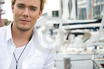 Young man at a yachtclub