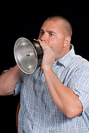 Young Man Yelling Through A Metal Horn