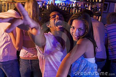 Young man and young woman dancing in a nightclub